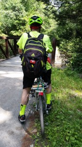 On bike with backpack